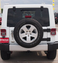 jeep wrangler 2011 white suv sahara gasoline 6 cylinders 4 wheel drive automatic 77388