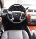 chevrolet suburban 2012 black suv ltz 1500 flex fuel 8 cylinders 2 wheel drive automatic 76051