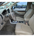 nissan pathfinder 2011 dk  brown suv le gasoline 6 cylinders 2 wheel drive automatic 78233