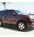 honda pilot 2011 dk  red suv ex l w dvd gasoline 6 cylinders front wheel drive automatic 77566