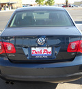 volkswagen jetta 2006 blue sedan 2 5 pzev gasoline 5 cylinders front wheel drive automatic 79925