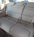 honda odyssey 2006 white van touring gasoline 6 cylinders front wheel drive automatic with overdrive 77074