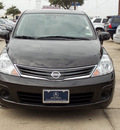 nissan versa 2011 black hatchback 1 8 s 4 cylinders automatic with overdrive 77074