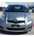 toyota yaris 2009 green hatchback gasoline 4 cylinders front wheel drive automatic 76543