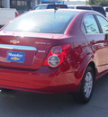 chevrolet sonic 2012 red sedan gasoline 4 cylinders front wheel drive 6 spd auto connivity plus cruise pkg lpo,all wthr flr mats l 77090