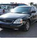 ford five hundred 2006 black sedan sel gasoline 6 cylinders front wheel drive automatic 77018