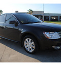 ford taurus 2009 black sedan se gasoline 6 cylinders front wheel drive automatic with overdrive 77539
