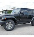 jeep wrangler unlimited 2013 black suv rubicon gasoline 6 cylinders 4 wheel drive automatic 77515