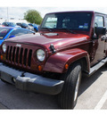 jeep wrangler unlimited 2007 red suv sahara gasoline 6 cylinders rear wheel drive automatic 78729