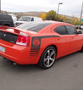 dodge charger 2009 orange sedan srt8 8 cylinders automatic 99352
