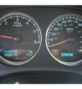 chevrolet tahoe 2009 white suv ltz flex fuel 8 cylinders 2 wheel drive automatic 76543
