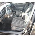 volkswagen gti 2010 black hatchback gasoline 4 cylinders front wheel drive 6 speed manual 77034