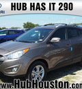 hyundai tucson 2013 brown gls gasoline 4 cylinders front wheel drive autostick 77065