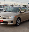toyota corolla 2011 tan sedan le gasoline 4 cylinders front wheel drive automatic with overdrive 77074