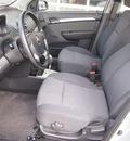 chevrolet aveo 2011 silver sedan lt 4 cylinders automatic 77656