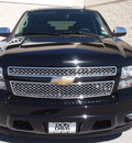 chevrolet tahoe 2010 black suv lt flex fuel 8 cylinders 2 wheel drive automatic 76011