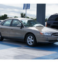 ford taurus 2003 beige sedan se 6 cylinders automatic 77094