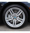 bmw 5 series 2012 black sedan 550i gasoline 8 cylinders rear wheel drive 6 speed manual 77002