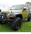 jeep wrangler unlimited 2008 lt  green suv x 6 cylinders 6 speed manual 33157