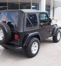 jeep wrangler 2004 black suv rubicon gasoline 6 cylinders 4 wheel drive 5 speed manual 76049