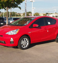 toyota prius c 2012 red hatchback three 4 cylinders automatic 76116