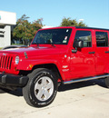 jeep wrangler unlimited 2010 red suv sahara gasoline 6 cylinders 4 wheel drive automatic with overdrive 76011