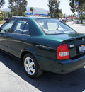 mazda protege 2000 green sedan es 4 cylinders 5 speed with overdrive 92882