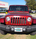jeep wrangler unlimited 2007 red suv sahara gasoline 6 cylinders rear wheel drive automatic 75067