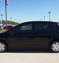 nissan versa 2011 black hatchback 1 8 s gasoline 4 cylinders front wheel drive automatic with overdrive 76018