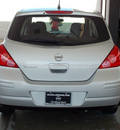 nissan versa 2011 silver hatchback 1 8 s gasoline 4 cylinders front wheel drive automatic with overdrive 77477