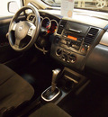nissan versa 2011 silver hatchback 1 8 s gasoline 4 cylinders front wheel drive automatic 75219