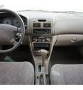toyota corolla 1999 lt  brown sedan le 4 cylinders automatic 77094