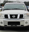 nissan armada 2004 white suv le gasoline 8 cylinders rear wheel drive automatic 33884