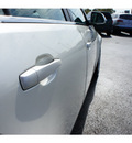 cadillac cts 2009 white sedan 3 6l v6 gasoline 6 cylinders rear wheel drive automatic 77074