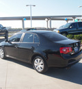 volkswagen jetta 2006 black sedan value edition pzev gasoline 5 cylinders front wheel drive automatic 76137