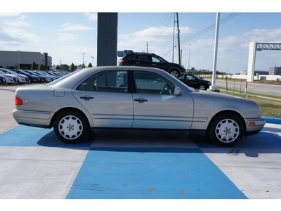mercedes benz e class 1999 gold sedan e320 gasoline 6 cylinders rear wheel drive automatic 77094