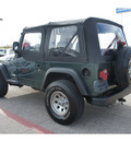 jeep wrangler 2003 green suv se gasoline 4 cylinders 4 wheel drive 6 speed manual 76543