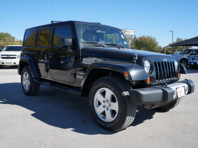 jeep wrangler unlimited 2011 black clear coat suv sahara gasoline 6 cylinders 4 wheel drive manual 75080