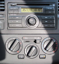 nissan versa 2009 gray hatchback gasoline 4 cylinders front wheel drive manual 33884