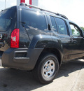 nissan xterra 2011 gray suv gasoline 6 cylinders 2 wheel drive 5 speed automatic 77521