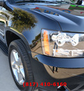 chevrolet tahoe 2012 black suv ltz w navigation flex fuel 8 cylinders 2 wheel drive automatic 76051