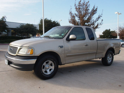 ford f 150 1999 gold xlt gasoline v8 rear wheel drive automatic with overdrive 76011