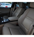 bmw x5 2009 white suv xdrive48i gasoline 8 cylinders all whee drive automatic 77002