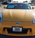 nissan 370z 2009 yellow coupe touring gasoline 6 cylinders rear wheel drive automatic 76018