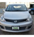nissan versa 2010 white hatchback 1 8 sl gasoline 4 cylinders front wheel drive automatic 78757