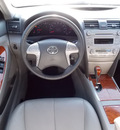 toyota camry 2010 white sedan xle v6 6 cylinders shiftable automatic 77074