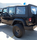 jeep wrangler unlimited 2010 black suv sport gasoline 6 cylinders 2 wheel drive automatic 78130