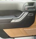 jeep wrangler unlimited 2012 black suv sahara gasoline 6 cylinders 4 wheel drive automatic 77074