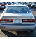 toyota camry 1999 beige sedan le gasoline 4 cylinders front wheel drive automatic 76543