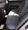 cadillac ats 2013 white sedan 2 0l premium gasoline 4 cylinders rear wheel drive automatic 77074